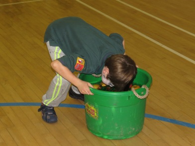 ...And apple bobbing in uniform - let's hope his make-up didn't run!